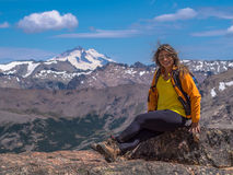 Trekking in Patagonia. Woman with backpack enjoyed the scenery the rocks of Cerro Catedral, with snowy Mount Tronador in the background - Bariloche - Patagonia Stock Photography