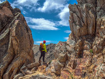 Trekking in Patagonia. Woman with backpack walks on the rocks of Cerro Catedral - Bariloche - Patagonia - Argentina Royalty Free Stock Photography