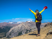 Trekking in Patagonia. Woman with backpack walks on the rocks of Cerro Catedral, with snowy Mount Tronador in the background - Bariloche - Patagonia - Argentina Royalty Free Stock Image