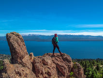 Trekking in Patagonia. Woman with backpack walks on the rocks of Cerro Otto - Bariloche - Patagonia - Argentina Royalty Free Stock Images