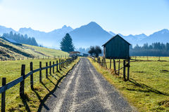 Trekking path in the morning surrounded by mountains. Beautiful valley after sunrise surrounded by the Allgäu Alps, Oberstdorf, Germany Stock Image