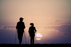 Trekking people at sunset Stock Photography