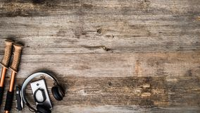 Trekking pole, mobile phone and headpnones on wooden background Stock Images