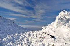 Trekking poles. On a hillside covered with snow royalty free stock photos