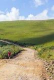 Trekking on the Road. Girl trekking on the dirt road in Cambara do Sul, Rio Grande do Sul, Brazil Royalty Free Stock Photo
