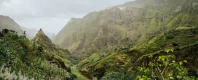 Trekking route to the Xo-Xo Valley. Harsh peaks and immense mountain walls around the ravine. Local dwellings built on. The mountain ridge. Santo Antao island Stock Photo