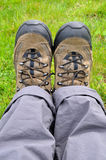 Trekking shoe. S and a green background stock images