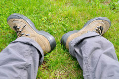 Trekking shoe. S and a green background stock image
