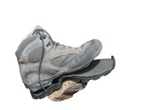 Trekking shoe broken after intensive use (isolated) Royalty Free Stock Photography