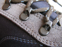 Trekking shoes. Detail of trekking shoes with laces and suede insert royalty free stock image