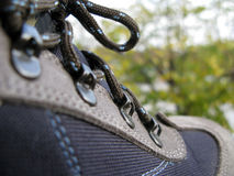 Trekking shoes. Detail of trekking shoes with nature background royalty free stock photos