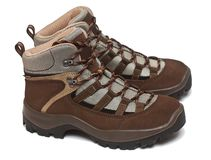 Trekking shoes. A pair of woman's trekking shoes over white background royalty free stock photos