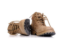 Trekking shoes. Pair of leather trekking shoes isolated on white background royalty free stock photos