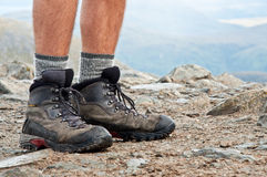 Trekking shoes. Hiking shoes on the summit in Scotland Royalty Free Stock Image