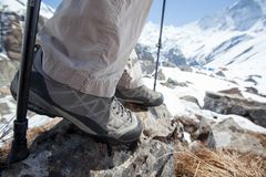 Trekking shoes in mountains closeup.  stock photos