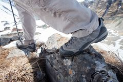 Trekking shoes in mountains closeup. Trekking shoes in mountains close up stock images