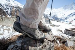 Trekking shoes in mountains closeup. Trekking shoes in mountains close up stock photography