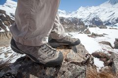 Trekking shoes in mountains closeup. Trekking shoes in mountains close up stock photos