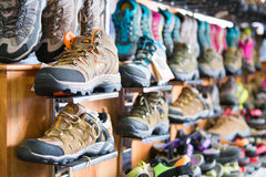 Trekking shoes for sell in clothing shop Royalty Free Stock Photos
