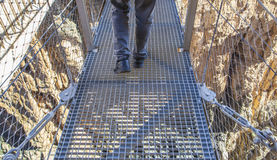 Trekking shoes on suspension bridge at Caminito del Rey. Trekking shoes over suspension bridge at Caminito del Rey path, Malaga, Spain royalty free stock photography