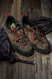 Trekking shoes. On wooden bakcground stock image