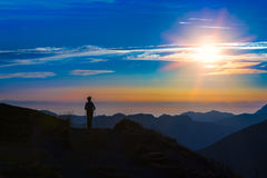 Trekking in silhouette Royalty Free Stock Image