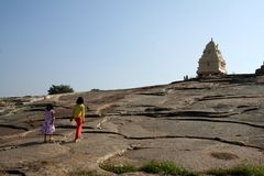 Trekking Sisters. Two sisters climbing rock bed to reach Kempegowda Tower at Lal Bagh, Bangalore, India, Asia Stock Image