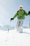 Trekking in snow Royalty Free Stock Photo