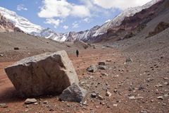 Trekking to Aconcagua National Park. Lonely mountaineer up to the Plaza Francia viewpoint, near the upper glacier Horcones. Aconcagua National Park Stock Photos
