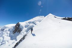 Trekking to the top of Mont Blanc mountain in French Alps stock photography