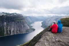 Trekking to Trolltunga cliff with view on Ringedalsvatnet lake, royalty free stock image