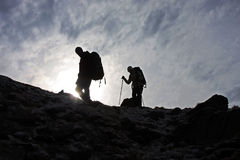 Trekking on top of the mountain Royalty Free Stock Photos