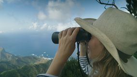 Trekking on the top of the volcano and review with binoculars. Trekking on top and review with binoculars stock video footage