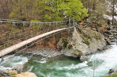 Trekking trail and suspension brigde. Italian Alps Royalty Free Stock Photos