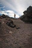 Trekking Vocano Pacaya in Guatemala. Volcano Pacaya National Park, Guatemala -March 3, 2016: One person on the trail towards Pacaya Volcano. Volcanic rock Stock Images