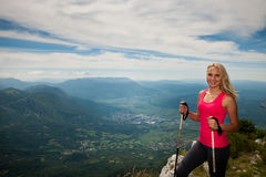 Trekking - woman hiking in mountains on a calm sumer day Royalty Free Stock Photo
