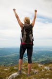 Trekking - woman hiking  in mountains on a calm sumer day being Royalty Free Stock Photo