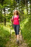 Trekking - woman hiking in mountains on a calm sumer day Stock Photos