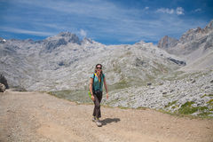 Trekking woman looking in Picos de Europa Royalty Free Stock Images