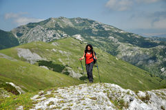 Trekking woman in the mountains Stock Photography