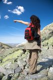 Trekking woman pointing left Royalty Free Stock Photo