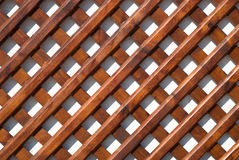 Trellis. Fragment of a wooden barrier stock photo