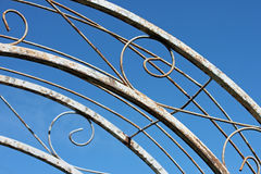 Trellis Arch Against a Blue Sky. Closeup of a Curving Trellis Arch Against a Blue Sky Royalty Free Stock Images