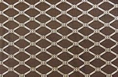Trellis en forme de diamant sur un fond brun fond pour la conception et la décoration images stock