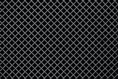 Trellis en métal sur un fond noir Photo stock