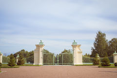 Trellis gate and fence of Lower garden Oranienbaum. LOMONOSOV, RUSSIA - AUGUST 20, 2014: Trellis gate and fence of Lower garden of the Palace and Park ensemble Stock Photography