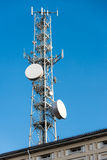 Trellis mobile antennas and satellite dishes. View of a trellis with mobile phone antennas and satellite dishes stock photo