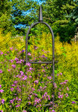 A Trellis Surrounded But Purple and Green Royalty Free Stock Photography
