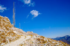 Trellis for telecommunications, radio transmitter on the summit of the tuscany Alps, overview. Stock Image