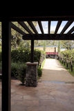 Trellis with Train. A trellis framing a beautiful landscaped view of a train in the distance Stock Images